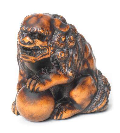 A large wood netsuke of a shishi  Edo period (1615-1868), 19th century