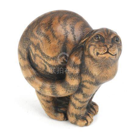 A boxwood netsuke of a wildcat By Jack Coutu (1924-2017), English, carved in January 1995 (2)
