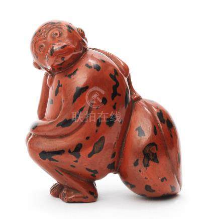 A  lacquered wood netsuke of a monkey Edo period (1615-1868), 18th century