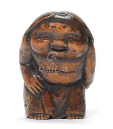 A wood netsuke of Okame Edo period (1615-1868), early-mid 19th century
