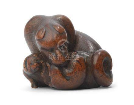 A wood netsuke of a bitch with two pups  By Masakazu, Nagoya, Edo period (1615-1868), mid-19th century