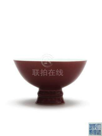 清乾隆 霁红釉高足碗  A COPPER RED STEM BOWL DECORATED WITH A RICH COPPER-RED GLAZE QING DYNASTY, QIANLONG SEAL MARK AND OF THE PERIOD