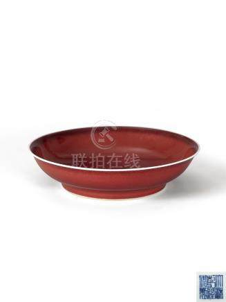 清乾隆 霁红釉盘 A COPPER-RED-GLAZED SAUCER DISH QIANLONG MARK AND OF THE PERIOD