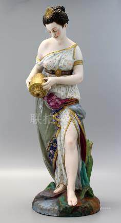 A Very Rare Antique Jean Gille (French 1845) porcelain figure of a lady holding a water vase.