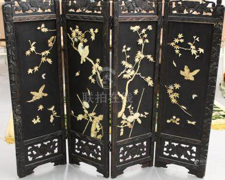 Chinese four-panel screen with carved bone decorations.