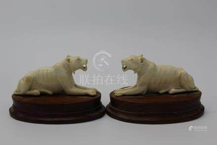 Pair of Indian carved bone lions.