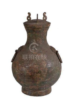 A Chinese archaic bronze storage vessel and cover