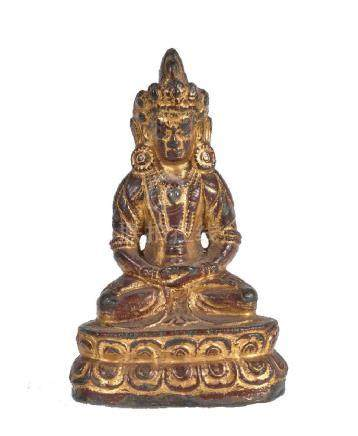 A Burmese lacquered and gilded bronze figure of