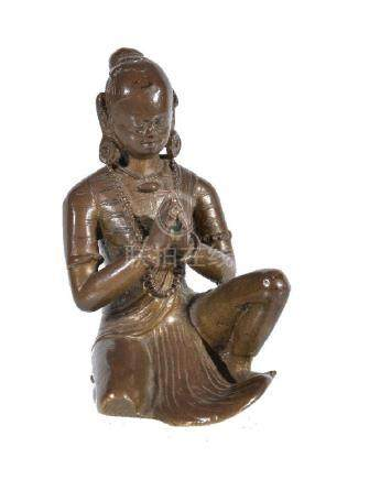 A Nepalese bronze portrait of a royal donor from a