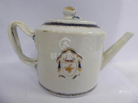 A late 18th/early 19thC Chinese porcelain armorial teapot of drum design with an angled spout,