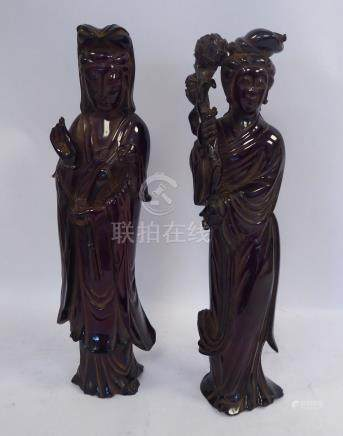 A pair of early 20thC moulded, dark ochre coloured resin figures,