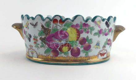 An early/mid 20th century Chinese two handled trough of oval form decorated in coloured enamels