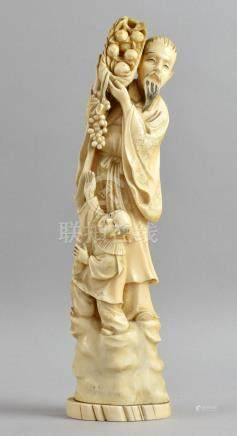 Late 19th/early 20th century Chinese carved ivory figure of a robed bearded man holding a basket