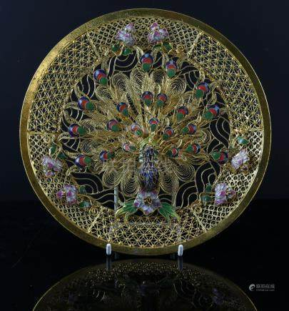 Gilt metal, filigree and enamel dish decorated with a peacock, 20.5cm diameter,