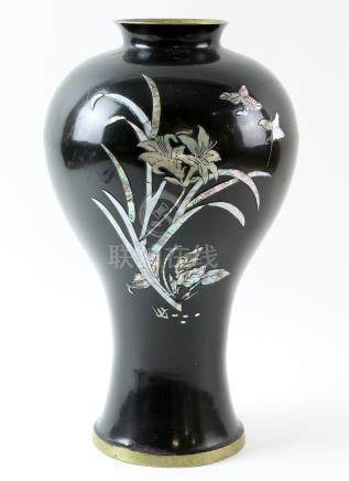 Chinese black enamelled Mei Ping vase inset with mother of pearl decoration of flowers and birds,