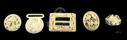 Chinese carved ivory belt buckle with dragon decoration, floral carved ivory brooch and other items,