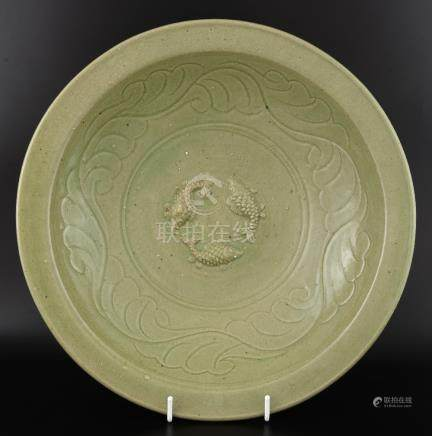 Modern Chinese celadon dish with applied decoration of three fish framed by moulded decoration of