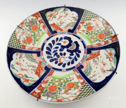 Early 20th century Chinese porcelain charger decorated with panels of birds and beasts, 46cm
