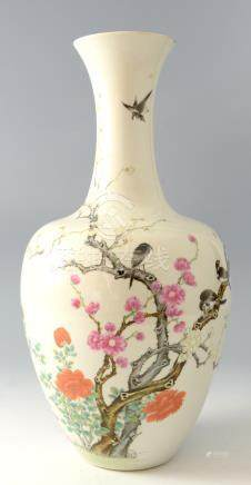 Chinese famille rose vase painted and enamelled in colours with four birds in blossoming shrubs with
