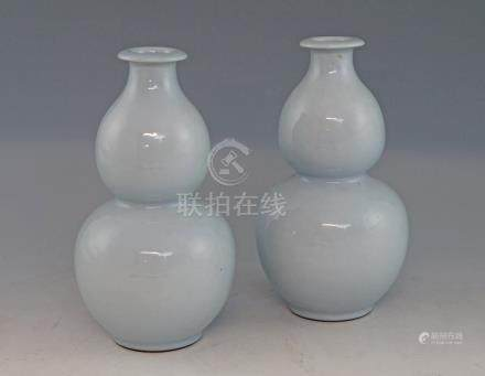 Pair of Chinese pale blue double gourd vases with flared rims, on round feet, blue seal marks to