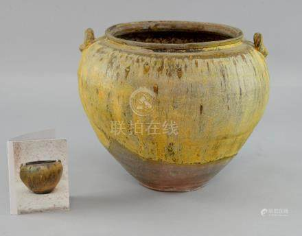 Chinese Zhou dynasty storage jar of ovoid form in a yellow/brown glaze, with loop handles, 23cm