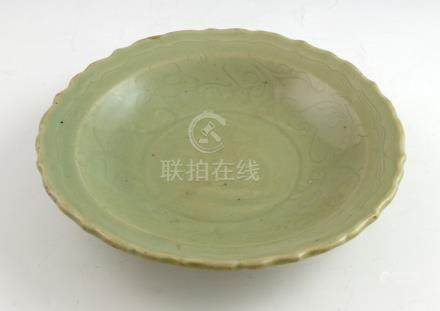 Early Ming Chinese celadon dish with incised geometric decoration to the centre, surrounded by