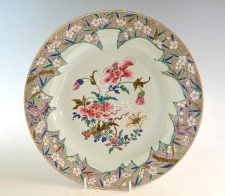 18th century Chinese famille rose porcelain charger decorated with flowers within a floral and