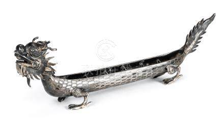 *Silver Dish. Oriental silver dish in the shape of a Chinese dragon, decoratively finished with