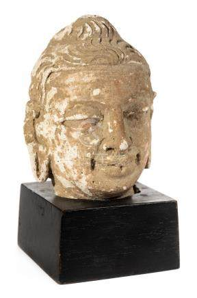 *Buddha. An ancient Sino-Tibetan terracotta head of Buddha, well modelled with elongated earlobes,