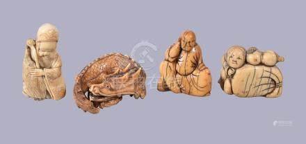 ϒ A Japanese Ivory Netsuke of triangular section carved as a boy holding a double-gourd