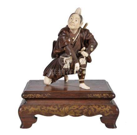 ϒ A Japanese Wood and Ivory Figure of a Yamabushi