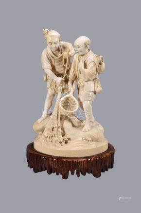 ϒ A Japanese ivory Okimono of Fishermen