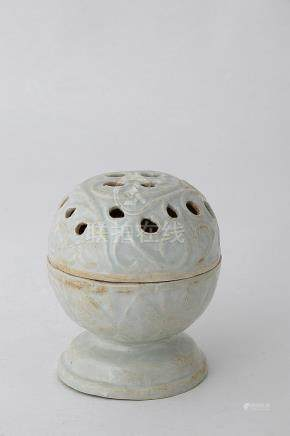 A QINGBAI-GLAZED PIERCED AND MOULDED INCENSE BURNER Southern