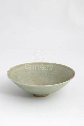 A QINGBAI-GLAZED CARVED 'FLOWER' BOWL, WANSouthern Song dyna