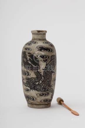 Bottle-shaped snuff bottle - China, late Ming, early Qing Unglazed porcelain biscuit, depicting a