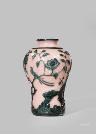 A CHINESE BEIJING GLASS PINK AND GREEN OVERLAY VASE 18TH/19TH CENTURY Carved with birds perched on