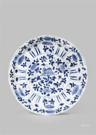 A CHINESE BLUE AND WHITE MOULDED DISH KANGXI 1662-1722 Painted to the centre with floral sprays