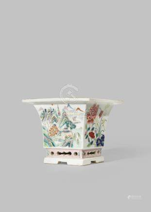 A CHINESE FAMILLE ROSE JARDINIERE 19TH CENTURY The square-section flared body painted with floral