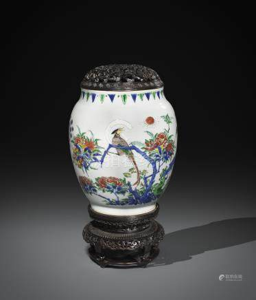 A RARE CHINESE WUCAI OVOID VASE TRANSITIONAL C.1640 Painted with a peacock in flight and a