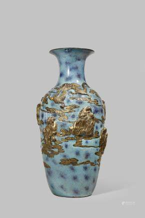 A CHINESE 'EIGHTEEN LUOHANS' VASE 19TH CENTURY With an ovoid body and a flared rim, decorated with