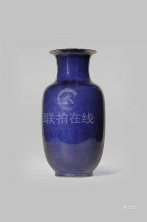 A CHINESE PURPLE-BLUE GLAZED VASE 18TH CENTURY With a plain ovoid body and a flared neck,