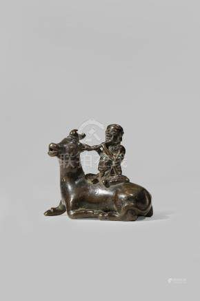A CHINESE BRONZE 'WATER BUFFALO' WATER DROPPER LATE MING DYNASTY Cast as a boy playing a flute