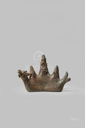 A CHINESE BRONZE 'YU LUNG MOUNTAIN' BRUSH REST MING DYNASTY Formed as a mythical creature emerging