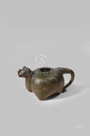 A SMALL CHINESE BRONZE TRIPOD WATER DROPPER PROBABLY LATE MING DYNASTY The bulbous body with a spout