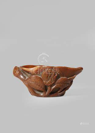 A CHINESE RHINOCEROS HORN 'MAGNOLIA' LIBATION CUP 17TH /EARLY 18TH CENTURY Carved as a large