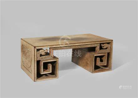 A CHINESE ZITAN WOOD STAND 18TH/19TH CENTURY Carved with angular scrolls and a key fret apron with