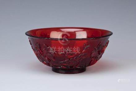 A CHINESE BEIJING RUBY-GLASS BOWL 18TH CENTURY Carved in relief with a single standing water bird