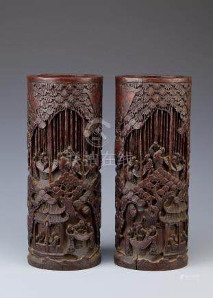 A PAIR OF CHINESE BAMBOO VASES LATE QING DYNASTY Carved with scholars appreciating scrolls and