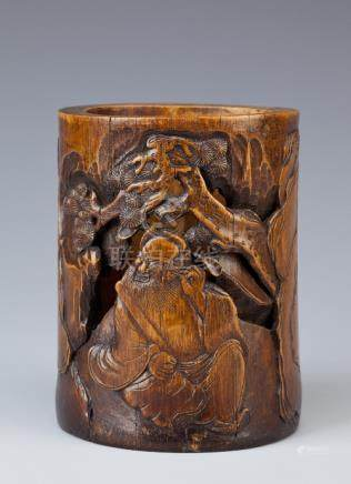 A CHINESE BAMBOO BITONG QING DYNASTY The cylindrical reticulated body carved with an Immortal seated