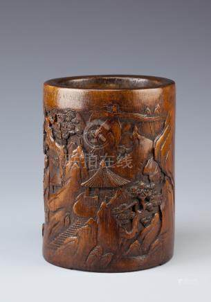 A CHINESE BAMBOO BITONG 19TH/20TH CENTURY The cylindrical body carved in shallow relief with
